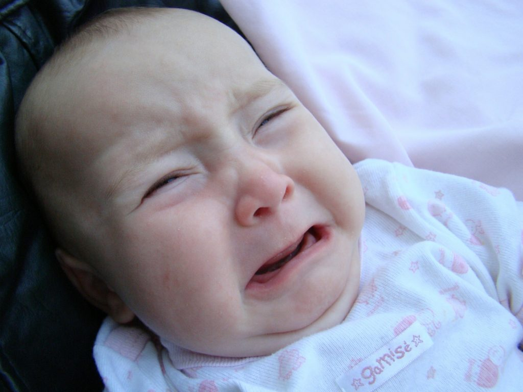 Why is My Baby Spitting Up Curdled Milk and Crying?